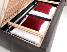 Upholstered storage for bedding with bed base